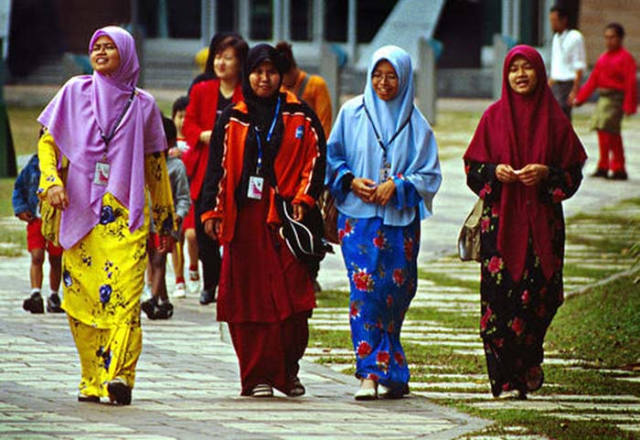 Malaysia Muslim women wearing the traditional tudong