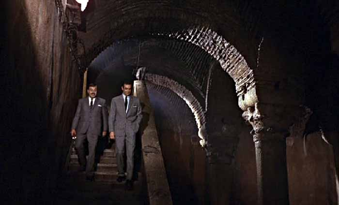 Bond and Kerim Bey descend the steps to the Cistern